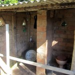toilet and bucket bathing area- who needs 4 walls when the breeze is nice?