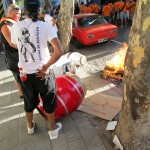 heatin' up drum heads at a free parade in Montevideo